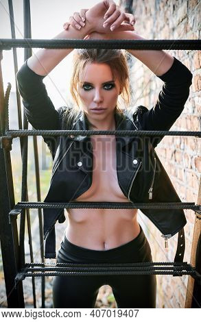 Fashion Shot: Sexy Beautiful Rock Girl (informal Model) Dressed In Black Leather Jacket And Pants St