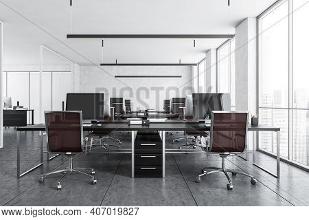 Office Room With Armchairs And Computers On The Tables Near Windows. Light Grey Office Room With Mod