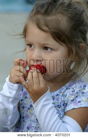 Girl Eating A Strawberry