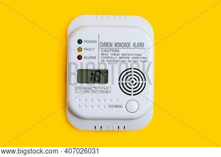 Carbon Monoxide Detector On A Yellow Background Co Detector