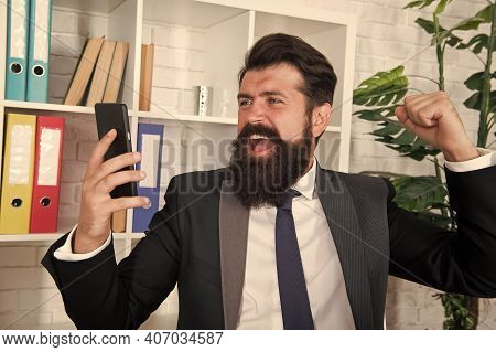 Lost His Temper. Angry Broker Punch Smartphone. Bearded Man Got Angry With Sms Information. De-stres