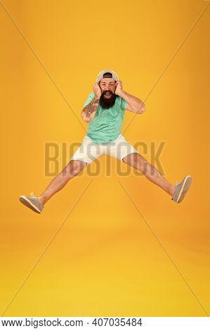 Amazing Stereo Sound. Summer Party. Man Listen Music Wireless Headphones. Bearded Guy Enjoy Music. H