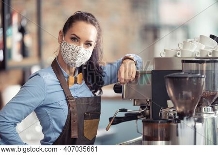 Woman Wears Protective Mask At Work, Working As A Waitress In A Coffee House.