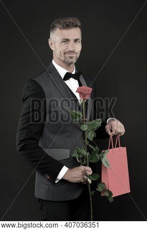 Ability To Surprise. Romantic Gentleman. Man Mature Confident Macho With Romantic Gift. Handsome Guy