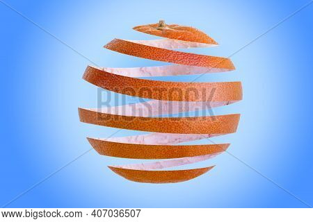 Grapefruit Peel Spiral In The Form Of An Grapefruit. Isolated On Blue Background.