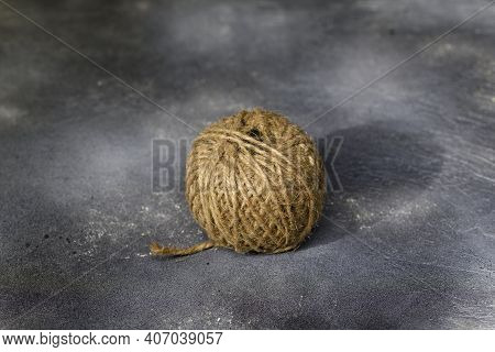 Tangle Of Jute Thread On Grey Background.