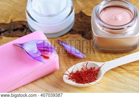 Saffron Soap, Purple Crocus Flowers And Dried Saffron Stigmas In Wooden Spoon. The Use Of Saffron In