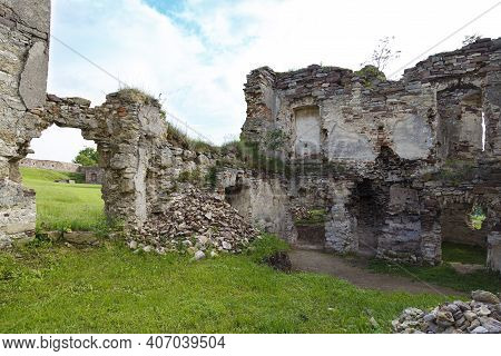 Scenic Ruins Of Ancient Castle Pidzamochok Among Green Grass. Buchach Region, Ternopil Oblast, Ukrai