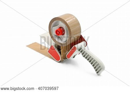 Brown Adhesive Packaging Tape Dispenser Isolated On A White Background