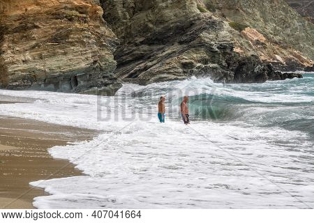 Folegandros, Greece - September 24, 2020: Tourists Relaxing In The Foamy Waters Of The Aegean Sea. A