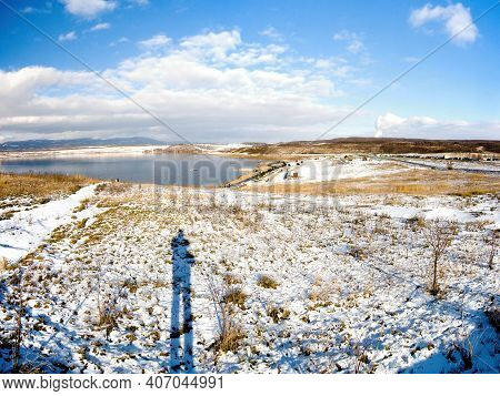 Most, Czech Republic - January 17, 2021: Most See And Ore Mountains In Sunny Winter