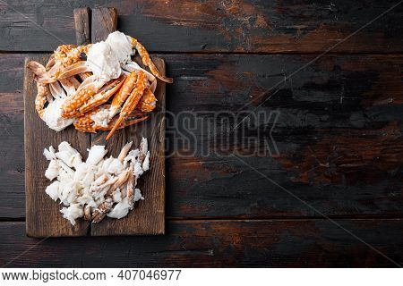 Boiled Blue Swimming Crab Claws Set, On Wooden Cutting Board, On Dark Wooden Background, Top View Fl