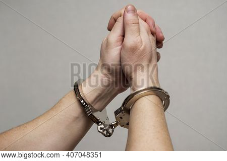 Handcuff On Mans Arms, Praying For Forgiveness. Chained Hands Praying. Praying Inmate.