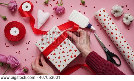 Step 9.step-by-step Instructions For Wrapping Gifts For Valentine's Day. Woman Wraps A Gift With Wra