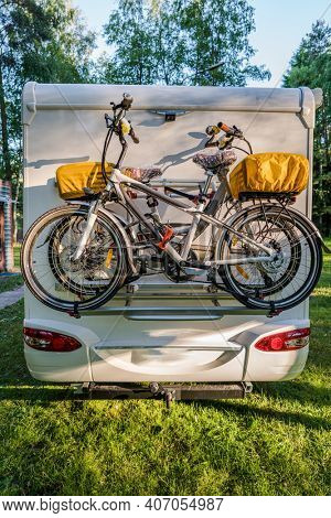 Two bicycles on a caravan. Family vacation travel RV, holiday trip in motorhome, Caravan car Vacation.