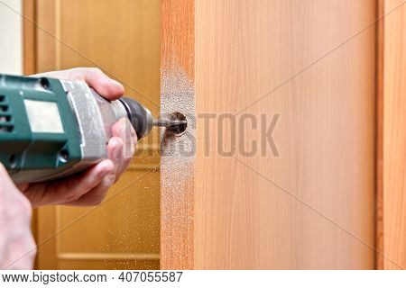 Locksmith Use Flat Bit To Wood When Drilling Hole For Latch.