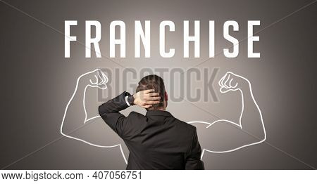 Rear view of a businessman with FRANCHISE inscription, powerfull business concept