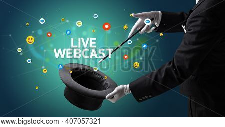 Magician is showing magic trick with LIVE WEBCAST inscription, social media marketing concept