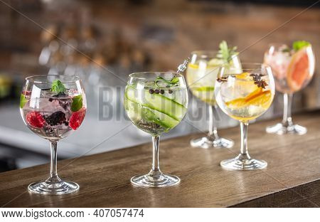 Gin Tonic Long Drink As A Classic Cocktail In Various Forms With Garnish In Individual Glasses Such