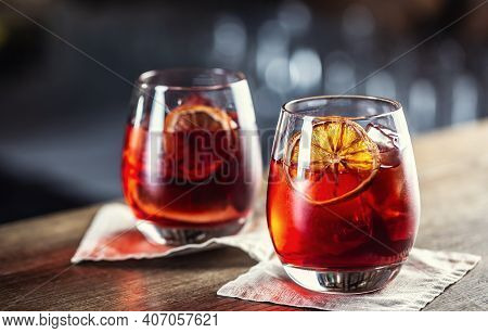 Negroni Classic Cocktail And Gin Short Drink With Sweet Vermouth, Red Bitter Liqueur And Dried Orang