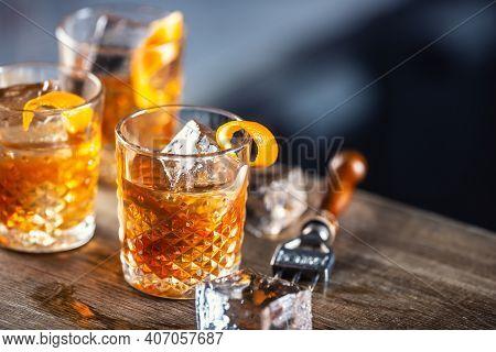 Old Fashioned Rum Drink On Ice With Orange Zest Garnish