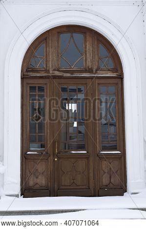 Ancient Wooden Door. Arched Door. Facade Of A Wooden Front Door With Windows.