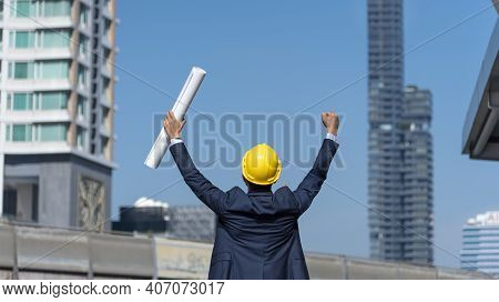 Construction Engineer In Safety Suit Trust Team Holding White Yellow Safety Hard Hat Security Equipm