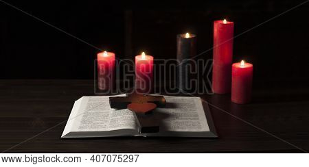 Open Bible Book On A Wooden Table. The Cross Of Jesus Is Wooden. Calvary
