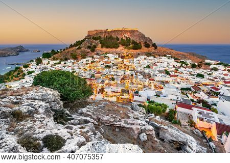 Lindos Small Whitewashed Village And The Acropolis, Rhodes, Greece.