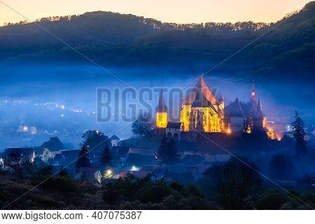 Biertan, Romania. Saxon Village With The Fortified Church In Transylvania, Mysty Autumn Fog Landscap