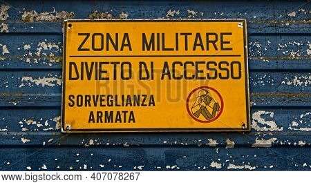 Military Area With Yellow Sign In Italian Language: \