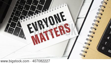 Everyone Matters Text On Paper With Office Background