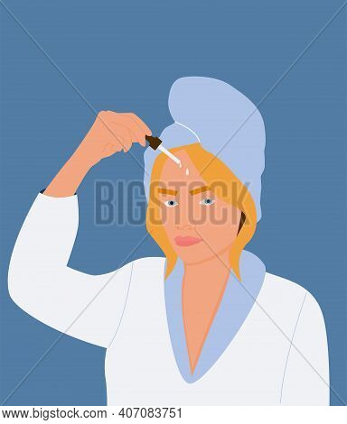 A Beautiful Young Blonde Woman Applies A Serum To Her Face. The Concept Of Facial Skin Care. A Girl