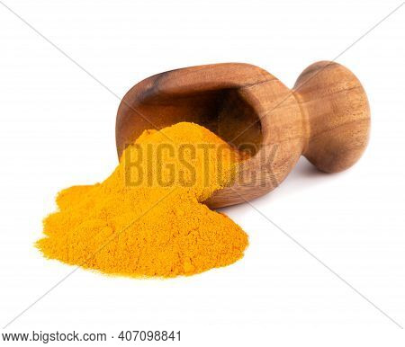 Dry Turmeric Powder In Wooden Scoop, Isolated On White Background. Curcuma Longa Linn.