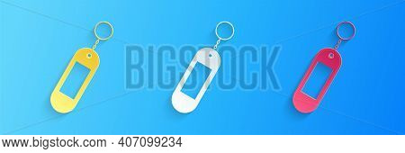 Paper Cut Key Chain Icon Isolated On Blue Background. Blank Rectangular Keychain With Ring And Chain