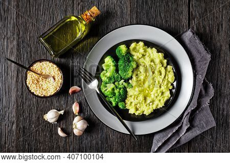 Broccoli Potato Mash Sprinkled With Chopped Almonds Served With Steamed Broccoli Florets On A Black