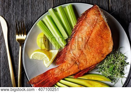 Cold-smoked Red Snapper Served With Celery Sticks, Avocado Slices And Microgreens On A Grey Platter