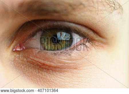 A Mans Eye. Macrophotography Of The Human Eye, Pupil And Eyelashes. High Quality Photo