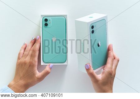 Unpacking Box Of Mint Green Iphone 11 With Dual Camera Of 2019 Release.