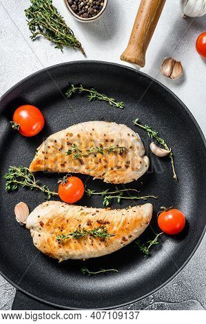 Grilled Turkey Steaks In A Pan. Breast Fillet. White Background. Top View
