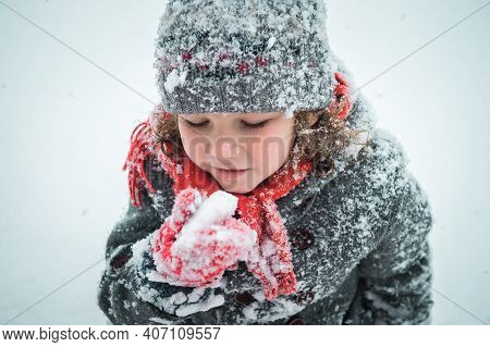 Child Eating Snow On Winter Fair. Kids Eat Toffee Apples On Christmas Market In Snow. Outdoor Fun On
