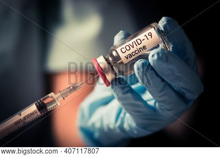 Female Doctor Holding A Covid-19 Vaccine