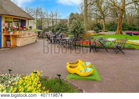 Keukenhof, Netherlands - April 4, 2016: Typical Yellow Dutch Wooden Shoes Clogs Or Klompen, Painted
