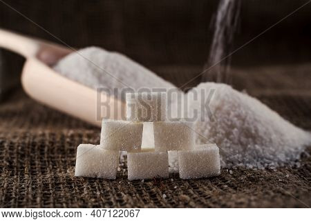 Sugar. Loose Sugar Lies In A Scoop On The Burlap. Sugar Is Poured Into The Slide