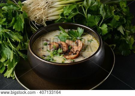 A Bowl Of Mushroom Cream Soup With Fried Champignons And Fresh Parsley. Winter, Autumn Hot Soup Conc