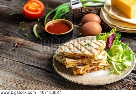 Mexican Tortilla Quesadilla With Scramble Eggs, Vegetables, Ham And Cheese, Mexican Cuisine, Mexico