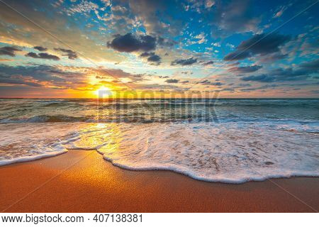 Beach Sunrise Over The Tropical Sea, Dramatic Clouds Over Ocean Waves
