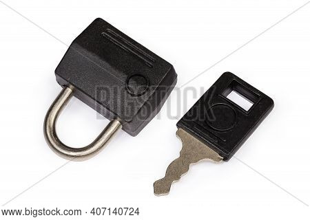 Locked Small Traditional Detachable Luggage Lock And Key To It On A White Background, Top View