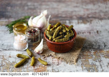 Pickled Gherkins. Bowl With Gherkins. Salt And Spices.