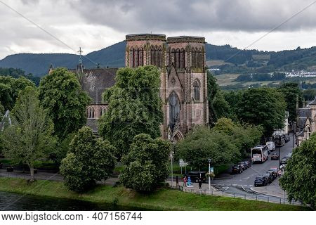 Inverness, Scotland - August 7, 2019: Inverness Cathedral, Dedicated To St Andrew With Ness River In